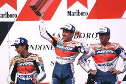 Podium: winner Tadayuki Okada, Honda, second place Mick Doohan, Repsol Honda Team, third place Alex Crivillé, Honda