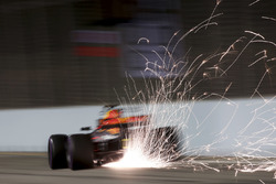 Sparks pour from the rear of Daniel Ricciardo, Red Bull Racing RB13