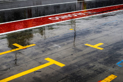 Rain in the pit lane