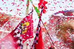 Ferrari flags at the podium celebrations