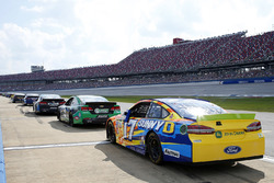 Ricky Stenhouse Jr., Roush Fenway Racing Ford, and 20 other cars serve penalties on pit road
