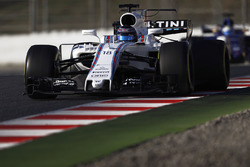 Lance Stroll, Williams FW40, leads Marcus Ericsson, Sauber C36