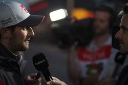 Romain Grosjean, Haas F1 Team, talks to the media
