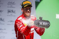 Race winner Sebastian Vettel, Ferrari, sprays Champagne from the podium