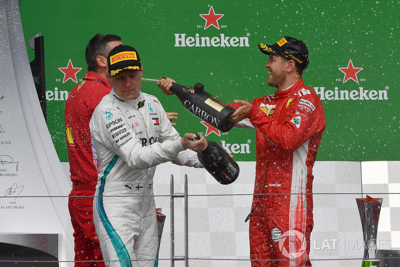 Valtteri Bottas, Mercedes-AMG F1 and Sebastian Vettel, Ferrari celebrate on the podium with the cham