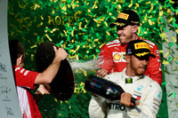 Lewis Hamilton, Mercedes-AMG F1 and Sebastian Vettel, Ferrari celebrate on the podium with the champagne