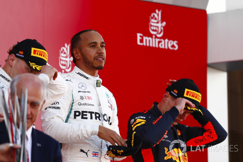 Lewis Hamilton, Mercedes AMG F1, celebrates victory on the podium with Valtteri Bottas, Mercedes AMG F1 and Max Verstappen, Red Bull Racing