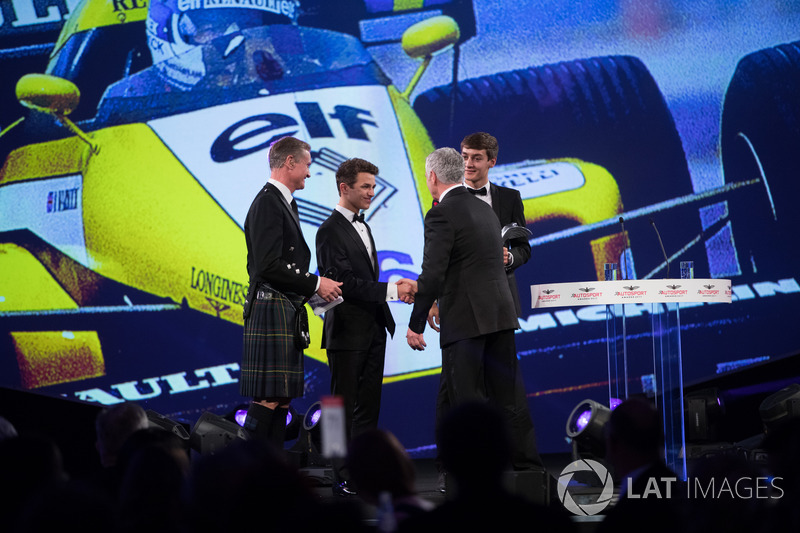 Derek Warwick on stage with Lando Norris and George Russell