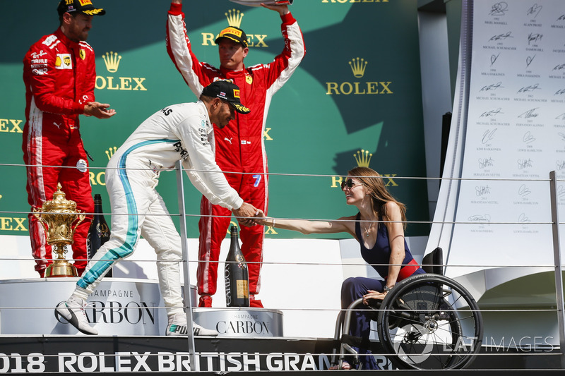 Lewis Hamilton, Mercedes AMG F1, 2nd position, shakes hands with Nathalie McGloin on the podium