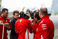 Sebastian Vettel, Ferrari, talks to Kimi Raikkonen, Ferrari. after qualifying