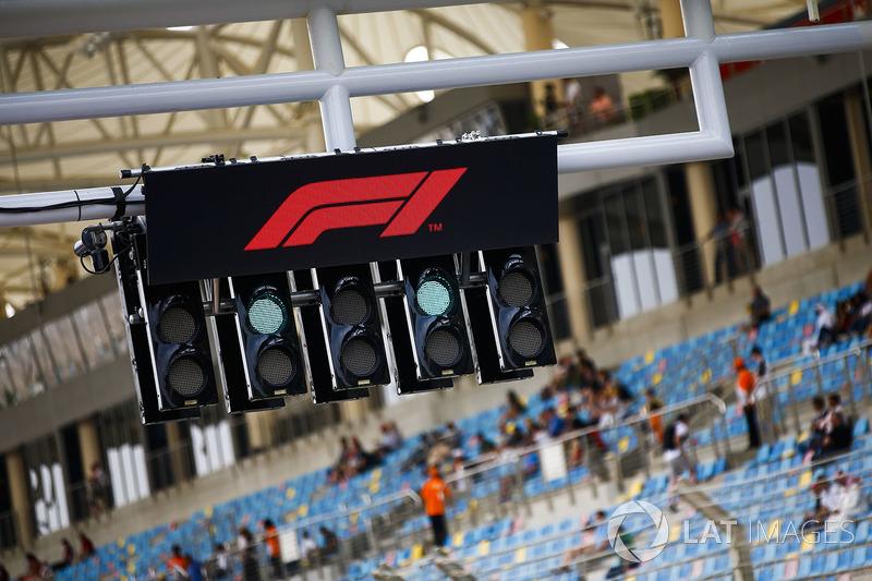 The F1 logo over the start lights