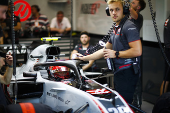 Kevin Magnussen, Haas F1 Team VF-18, in the garage with an engineer.