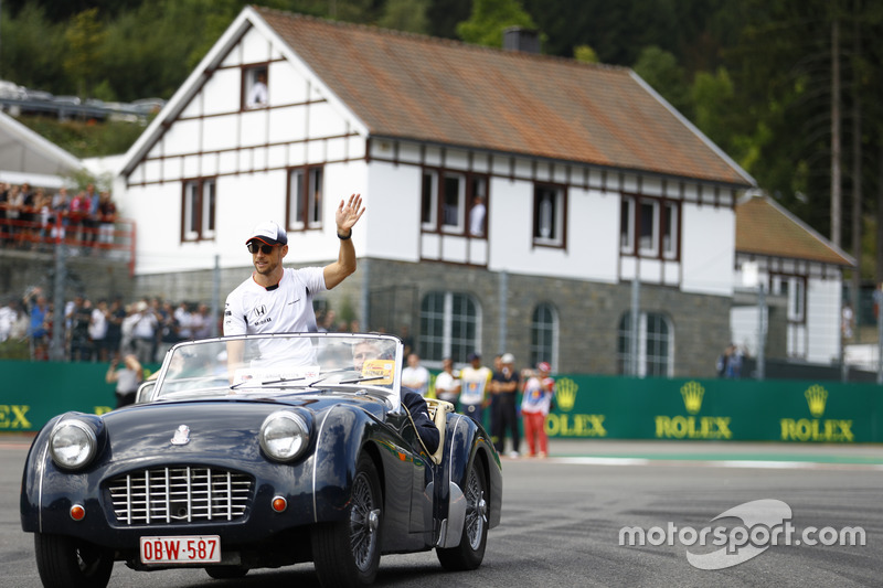 Jenson Button, McLaren waves from a Triumph on the drivers' parade