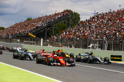 Sebastian Vettel, Ferrari SF70H, Lewis Hamilton, Mercedes AMG F1 W08, lead the field away at the start