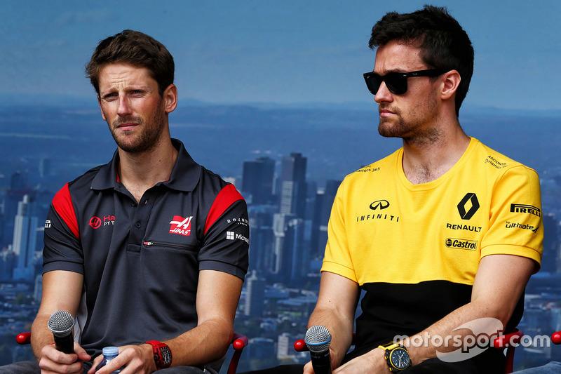 Romain Grosjean, Haas F1 Team con Jolyon Palmer, Renault Sport F1 Team