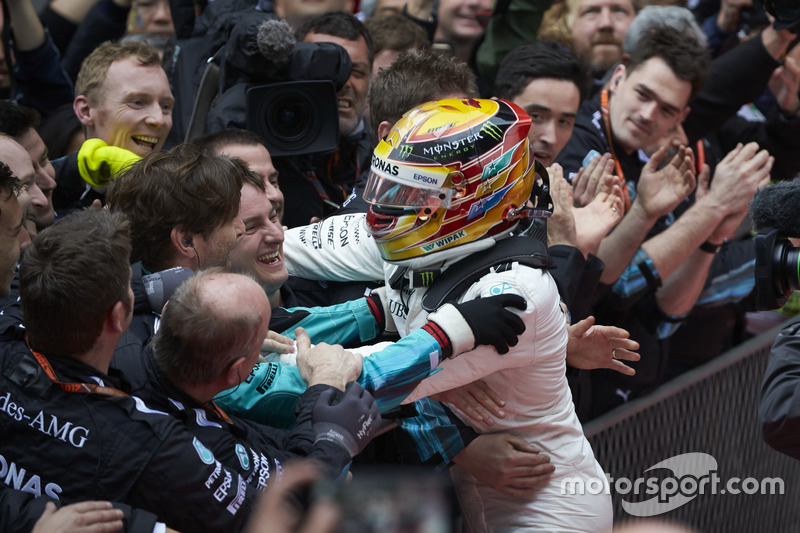 Lewis Hamilton, Mercedes AMG, celebrates with his team on arrival in parc ferme