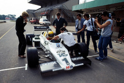 Ayrton Senna, receives final instructions prior to testing the Williams FW08C for the first time