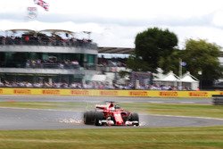 Sebastian Vettel, Ferrari SF70H, runs off the road with a front puncture