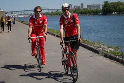 Sebastian Vettel, Ferrari, his trainer Antti Kontsas, on a bike