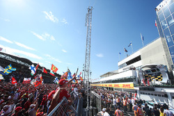 Fans cheer for Race winner Sebastian Vettel, Ferrari, Second place Kimi Raikkonen, Ferrari, Third place Valtteri Bottas, Mercedes AMG F1, on the podium