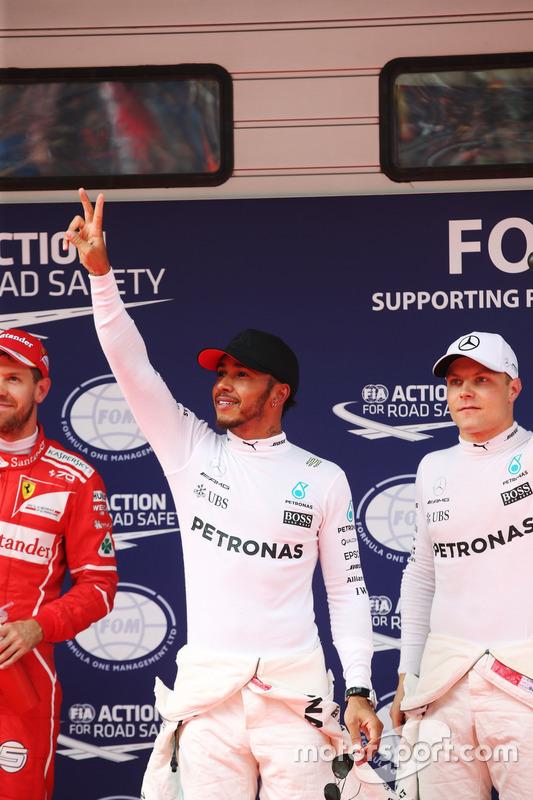 Sebastian Vettel, Ferrari, Lewis Hamilton, Mercedes AMG and Valtteri Bottas, Mercedes AMG