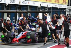 Haas F1 Team engineers move Romain Grosjean, Haas F1 Team VF-17, in the pit lane