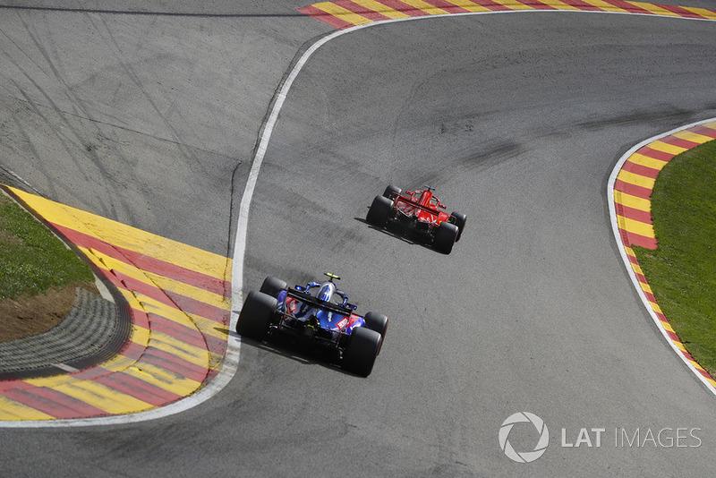 Pierre Gasly, Toro Rosso STR13, follows Sebastian Vettel, Ferrari SF71H