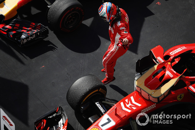 Kimi Raikkonen, Ferrari SF71H, jumps from his car as he celebrates winning the race in Parc Ferme