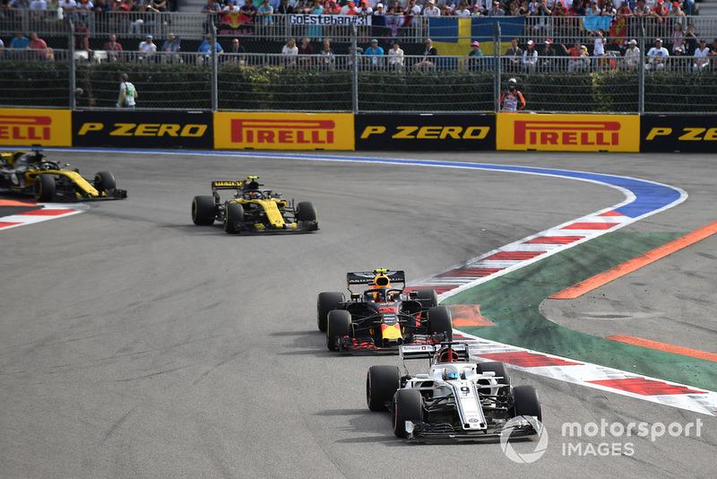 Marcus Ericsson, Sauber C37, Max Verstappen, Red Bull Racing RB14 and Carlos Sainz Jr., Renault Sport F1 Team R.S. 18