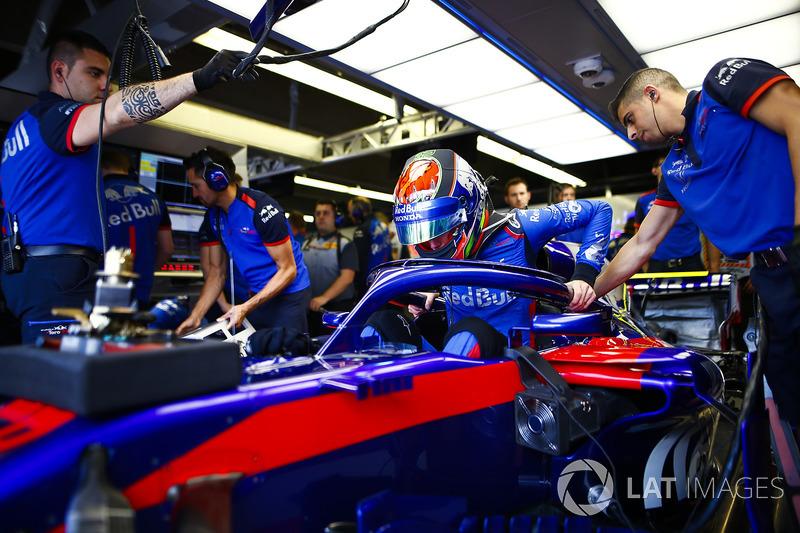 Pierre Gasly, Toro Rosso, enters his cockpit.