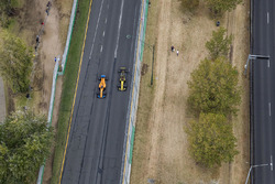 Fernando Alonso, McLaren MCL33 Renault, passes Carlos Sainz Jr., Renault Sport F1 Team R.S. 18