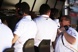 Eric Boullier, Racing Director, McLaren, talks with Zak Brown, Executive Director, McLaren Technology Group, on the McLaren pit wall
