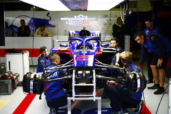 Toro Rosso mechanics work on the Brendon Hartley, Toro Rosso STR13, before the race