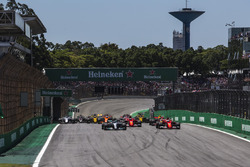 Valtteri Bottas, Mercedes-Benz F1 W08  and Sebastian Vettel, Ferrari SF70H battle for the lead at the start of the race