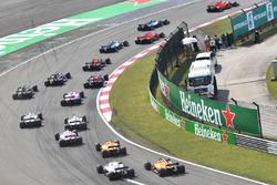 Sebastian Vettel, Ferrari SF71H and Kimi Raikkonen, Ferrari SF71H lead at the start of the race