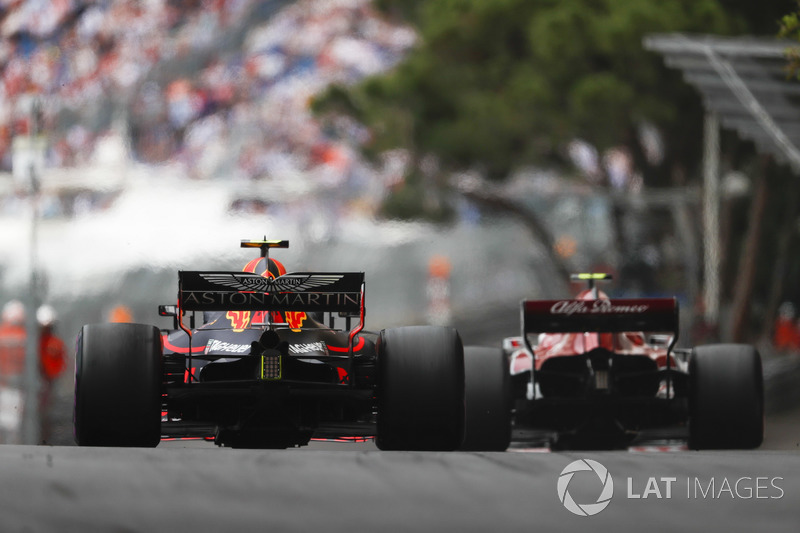 Charles Leclerc, Sauber C37, leads Max Verstappen, Red Bull Racing RB14