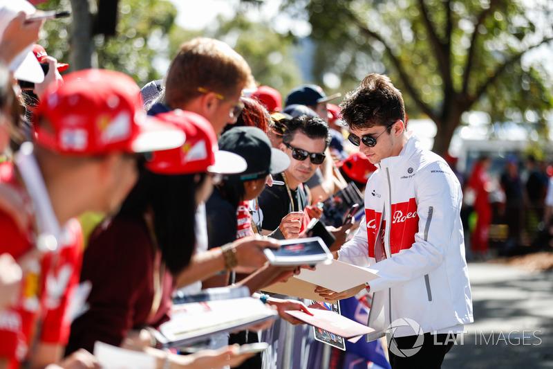 Charles Leclerc, Sauber, signs autographs for fans
