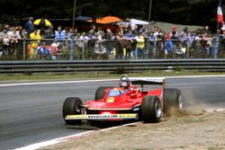 Gilles Villeneuve, Ferrari 312T4, corrects a slide as he puts a wheel on the kerb