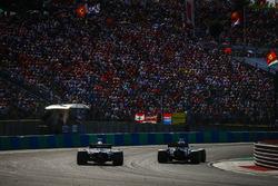 Carlos Sainz Jr., Renault Sport F1 Team R.S. 18, leads Romain Grosjean, Haas F1 Team VF-18