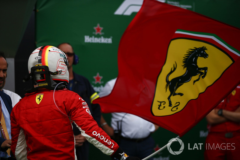 Sebastian Vettel, Ferrari, 1st position, waves the Ferrari flag in Parc Ferme