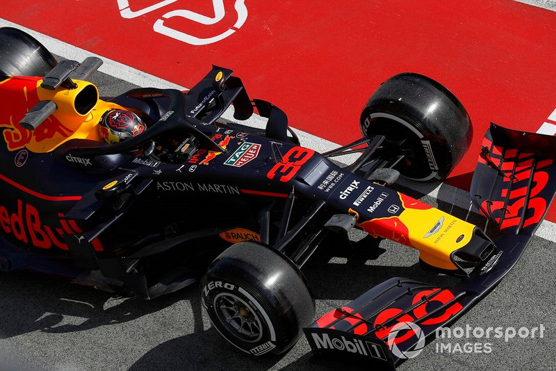Max Verstappen, Red Bull Racing RB15 stops in the pit lane