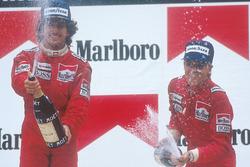 Podium: race winner Alain Prost, McLaren, second place Stefan Johansson, McLaren