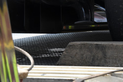 Fluid leaks from under the car of race retiree Fernando Alonso, McLaren MCL32