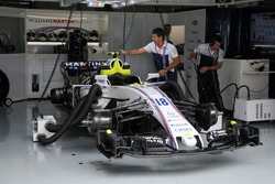 The car of Lance Stroll, Williams FW40 is worked on in the garage by mechanics