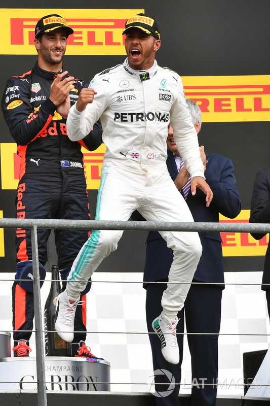 Race winner Lewis Hamilton, Mercedes AMG F1, celebrates on the podium