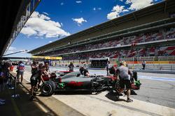 Romain Grosjean, Haas F1 Team VF-17, is returned to the Haas F1 Team garage