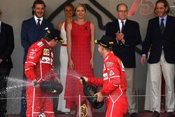 Kimi Raikkonen, Ferrari and Sebastian Vettel, Ferrari on the podium with the champagne