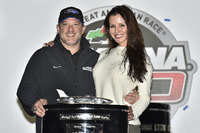 Tony Stewart and his girlfriend Pennelope Jimenez with the Harley J. Earl Trophy