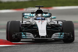 Valtteri Bottas, Mercedes AMG F1 W08, lifts a wheel bouncing over a kerb