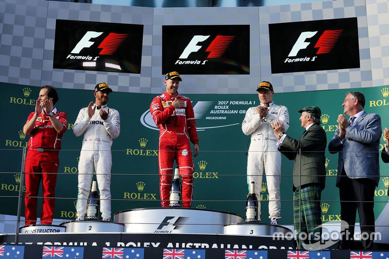 Podium: winner Sebastian Vettel, Ferrari, second place Lewis Hamilton, Mercedes AMG F1, third place Valtteri Bottas, Mercedes AMG F1, Sir Jackie Stewart